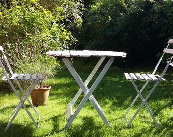Vintage garden table and two chairs.