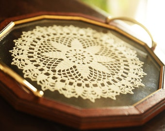 Wood and glass tray with doily doilies
