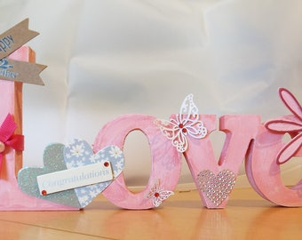 Wooden Plaque/Word/Sign/Ornament/Decoration - Love - Pink and White - Flowers/Hearts/Butterflies/Decorative/Gift/Celebration