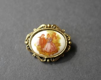 Tiny courting couple porcelain brooch