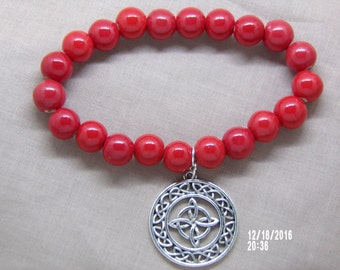 N1278 Red Acrylic Beaded Bracelet With a Celtic Metal Charm.