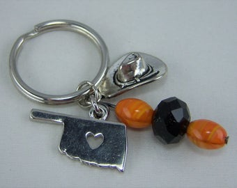 K214, Orange and Black Glass Beads with Oklahoma and Cowboy Hat Charm Key Chain