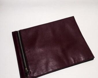 Burgundy leather clutch