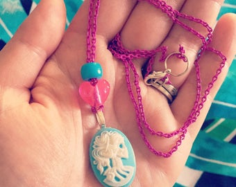 Blue skull cameo with beads on pink chain!