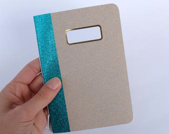 Notebook with blue glitter