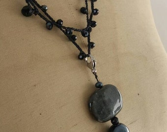 Long necklace with crystals and ceramic pendant