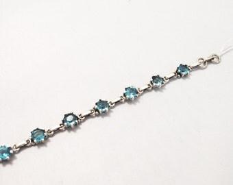 Silver and blue topaz stone bracelet