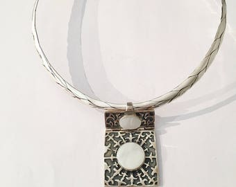Silver pendant and pearl stone