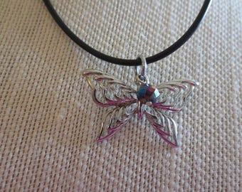 A cute Butterfly Pendant Necklace With A Colorful Bead