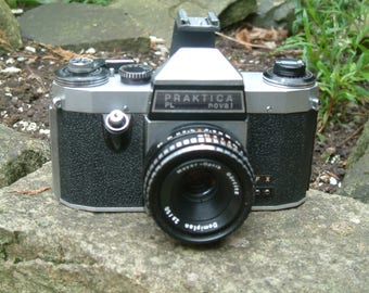 Vintage 1965 Praktica Nova 35mm SLR Camera with Meyer Optic Domiplan 50mm Lens. Complete with accessory shoe adapter. All working