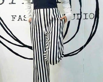 Black white striped trousers with a high waist.