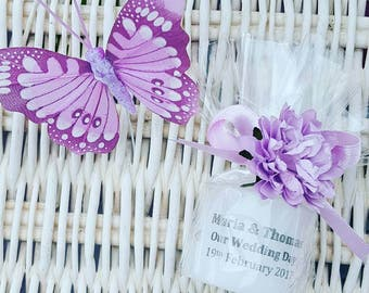 Lavender wedding personalised candle favours with flower embellishment.