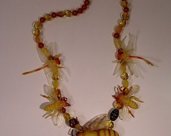 Necklace bees and dragonflies