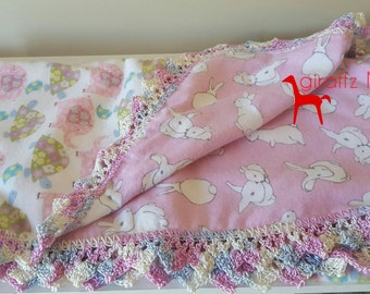 Pink reversible flannelette bunny rug with crochet edging