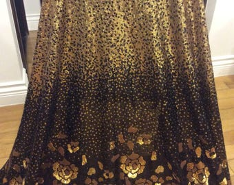 Sequined Fabric. Gold and Black.