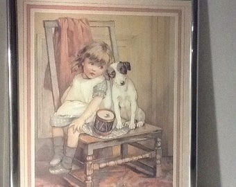 Vintage framed print of little girl with dog. Small girl with puppy on chair framed print.