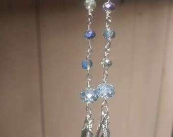 Blue glass crystal and feather earrings.