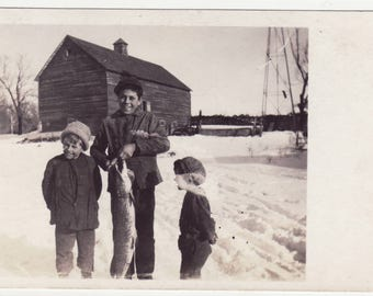 Vintage Real Photo Postcard Boy with Pike and Barn in Background