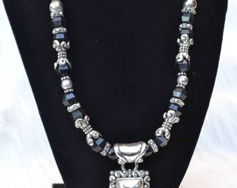 Intricate Silver and Black Beaded Necklace with Gorgeous Fancy Silver Pendant