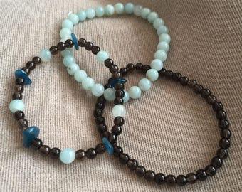 Stack of three 3 Stunning handmade Chocolate Brown Smokey Quartz , Teal Apatite and Pale Aqua Blue Amazonite beaded Bracelets Gemstone