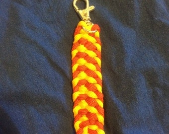 red and yellow paracord key chain