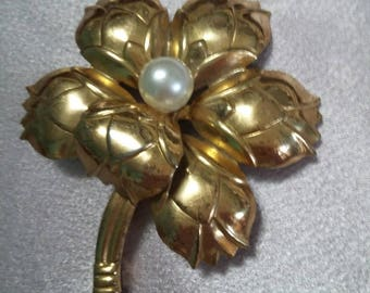 Gold and Pearl flower brooch marked sterling