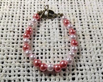 Peach pearl lock and key bracelet