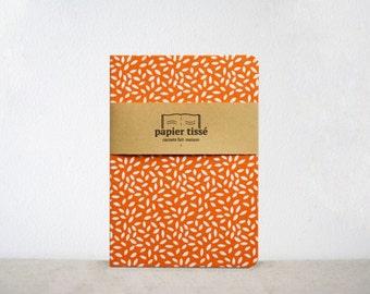 Orange notebook rice grain pattern