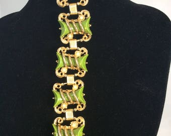 Unusual and fab 1950's Scrollwork Bracelet with Olive Green Medallions .