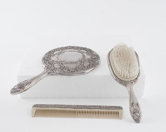 Vintage Silver Plated Lady's Vanity set of a Comb, Mirror and a Hair Brush
