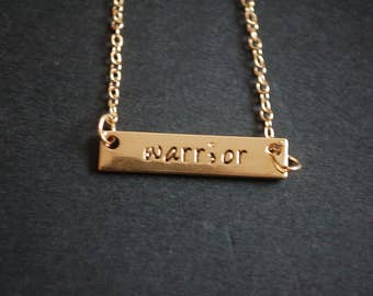Gold tone warrior necklace