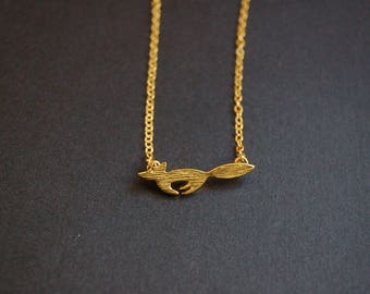 Gold tone running fox necklace