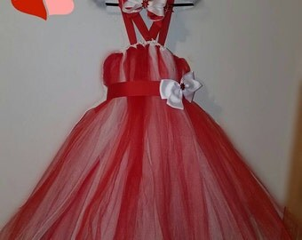 this is a red and white tutu dress with a matching bow. I can make any color you want.