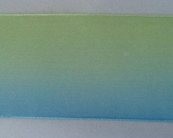 Sheer two tone ribbon - Blue graduating to green. Woven edge. 1.5 inches wide.