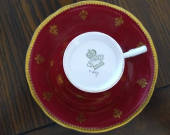 Aynsley red and gold fleur de lis pattern tea cup and saucer
