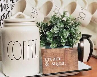Cream & sugar sign
