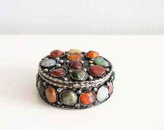 Small metal jewelry box.