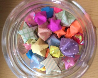 cute origami stars in small glass jar