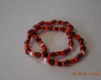 Red, black and white beaded bracelet