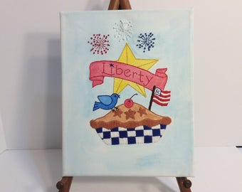 4th of July and Apple Pie with Fireworks.  American flag and fireworks.   Wall Art 8in by 10in. Canvas handmade.  Watercolors and stitching