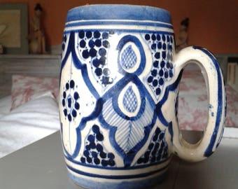Old blue mug glazed earthen