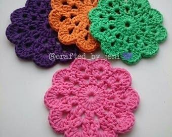 100% cotton crocheted flower drinks coasters/mats x4. Handmade. Protection. Multi-coloured. Pink. Green. Orange. Purple. 12cm-13cm diameter.