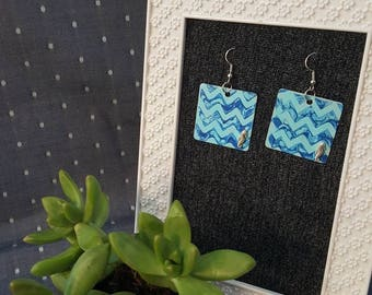 Dangling ocean themed chevron wave earrings with seahorse embellishments