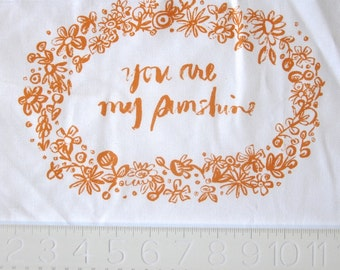 embroidery pattern on fabric You Are My Sunshine tangerine on white