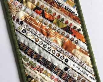Olive Green Quilted Mug Rug, Selvage strips, Scrappy Patchwork, Snack mat, Strip Pieced, large coaster, Candle Mat, Mouse Pad, Mini Quilt