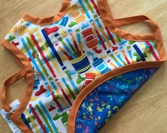 Reversible Apron Bib for Babies and Toddlers - Painter/Blue Batik w/ Orange Trim - Medium - 6 to 18