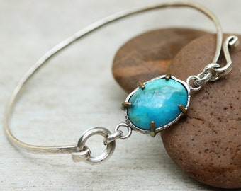 Oval blue turquoise bangle bracelet with oxidized and textured silver bangle