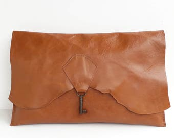 Raw edge leather clutch with vintage key - tan