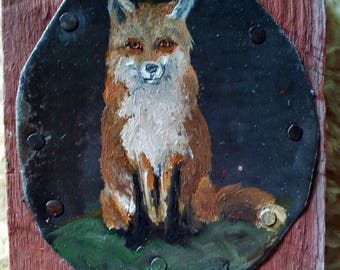 Sitting red fox on metal and wood