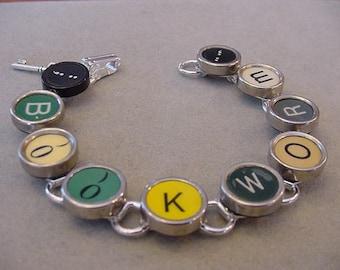 Typewriter key jewelry Bracelet  Spells BOOKWORM  Rare AQUA Typewriter key Bracelet